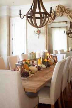 Perfection!!  Gorgeous wood table, upholstered chairs, wooden chandelier, fall tablescape