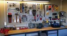 A very inviting workspace and a great customer submission (we have the best customers!). This well organized work area features Wall Control's Gray Metal Pegboard Panels, some Red Wall Control Pegboard Accessories, as well as conventional pegboard pegs and accessories showcasing the versatility of the Wall Control Pegboard Tool Storage System. Thanks for the great photo Darryl!