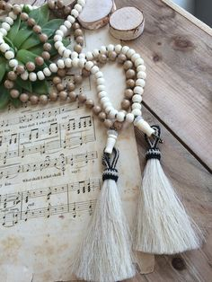 Long beaded necklaces with white horse hair tassles