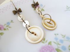 Antique Mother of Pearl Sewing Button Earrings-so cute with the little bows!