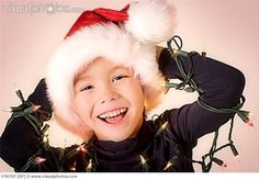Google Image Result for http://www.visualphotos.com/photo/2x3250664/young_boy_wrapped_in_christmas_lights_1793707.jpg