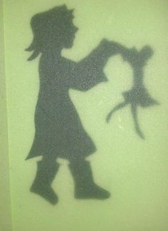 the girl with the wooden doll - silhouette carved out of black card