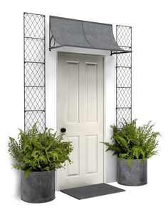 Hand made scoop front door canopy from Garden Requisites, shown with latticed wall trellis. www.garden-requisites.co.uk