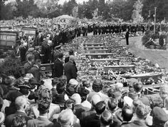 Funeral for victims of the Ballantyne's Department Store fire, at Ruru Lawn Cemetery, Bromley, Christchurch, 24 November Shows a row of coffi. Nz History, City Library, Canterbury, Department Store, Cemetery, Funeral, New Zealand, The Row, Lawn