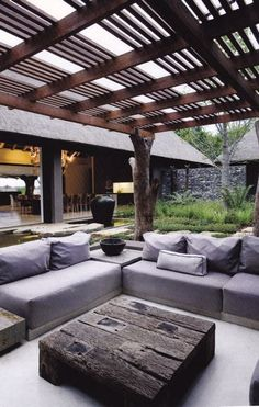 Modern Rustic Pergola A wood stump for pergola post, modern sofa, clean lines, and rough wood for centre table. This pergola is the perfect amalgamation of the modern design and rustic impressions. Outdoor Areas, Outdoor Seating, Outdoor Rooms, Outdoor Living, Outdoor Decor, Rustic Outdoor, Outdoor Furniture, Outdoor Lounge, Outdoor Tables