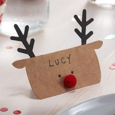 Dress your table in style this Christmas with these Kraft Reindeer shaped Christmas place cards. A great way to ensure your guests are seated in the perfect pl Christmas Party Table, Christmas Place Cards, Christmas Names, Christmas Bunting, Christmas Table Decorations, Xmas Cards, Kids Christmas, Christmas Crafts, Christmas Place Setting