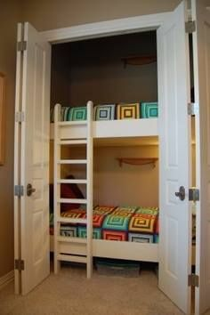 Bunks In The Closet, Leaves The Rest Of The Room As A Play Area. This Is A  GREAT Idea! I Would Take The Doors Off Though. Maybe Cute Curtains Instead.