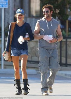 Settling down? Gerard Butler has been repeatedly seen with the same brunette beauty since late July and on Saturday, September 20th the two were once again enjoying each other's company in Malibu