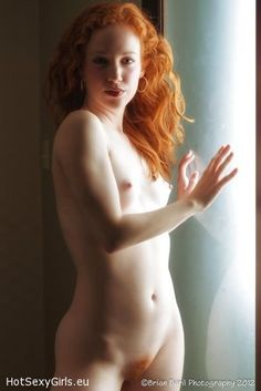 bush Nude redhead woman