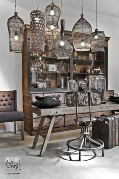 Home Decorating DIY Projects: Collection of basket style lighting hanging over a rustic table and dresser - Decor Object Decor, Wood Diy, Rustic Table, Salon Interior Design, Interior, Wicker Decor, Diy Decor, Lights, Home Decor