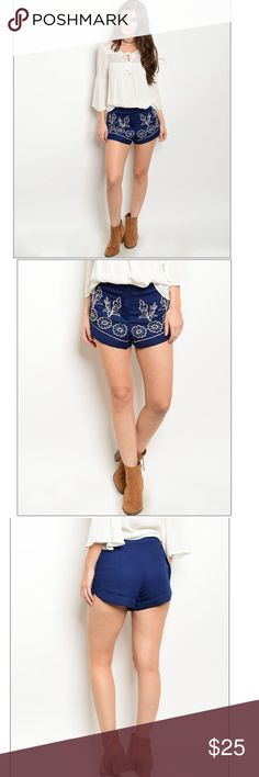 """Beautiful Floral pattern Navy Shorts Smock elastic waistband embroidery detail shorts. True to size. Measurements: Small: Waist:27"""". Length:11"""". Medium: Waist:28"""". Length:11.5"""". Large: 31"""". Length: 12"""". 🌸Bundle to save on shipping. 😘I like to move my stuff fast so offers are always welcomed. Shorts"""