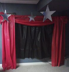 Plastic tablecloths can create a stage effect - use red and black.  Cardboard foil stars help set the scene.