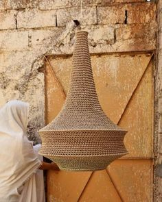 On the road to the Atlas Mountains at the far reach of Marrakesh city rests a little village where a community of women handcraft our crochet pendant Lampe Crochet, Crochet Lampshade, Small Pendant Lights, Pendant Lighting, Wood Pendant Light, Pendant Lamps, Diy, Pendants, Decoration