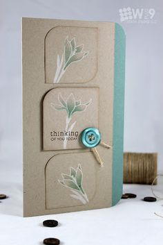 handmade card from Stamp Away With Me ... tall and narrow ... kraft and dusty teal ... column with a trio of rounded edge square ... white stamped flowers with a bit of brushed on Distress Ink ... great card ...