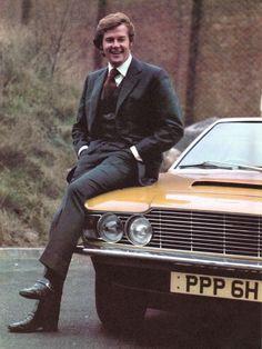 Roger Moore (Lord Brett Sinclair) on the hood of his Aston Martin DBS with original registration number (PPP Roger Moore, Estilo James Bond, James Bond Style, Tony Curtis, Aston Martin Lagonda, The Saint Tv Series, Classic Tv, Classic Cars, Martin Movie