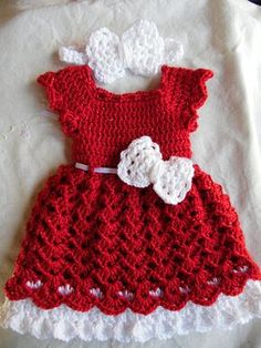 This listing is for a dress and headband set Made to order This dress is made out of red sparkly yarn with a white trim and a white ribbon that ties in the back. Some white ribbon may vary depending on what I have on hand. The pink bow is attached to the dress. The headband is made to