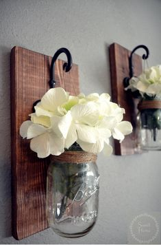 These rustic country style mason jar sconces are the perfect touch to your home decor. They bring warmth and beauty to any room. Comes in a set of (Flowers are optional) Our sconces are beautifully hand crafted using reclaimed wood. The wood is ligh Mason Jar Wall Sconce, Hanging Mason Jars, Mason Jar Vases, Mason Jar Flowers, Candle Wall Sconces, Mason Jar Crafts, Mason Jar Diy, Diy Jars, Glass Jars