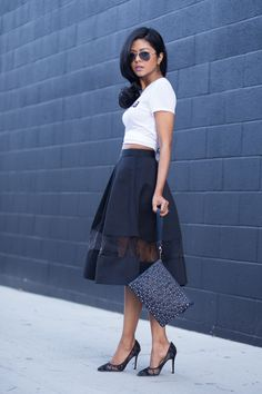 Blogger on Walk in Wonderland pairs an #Express skirt with an graphic tee for a look that's feminine with edge. #streetstyle #fashion