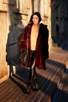A oxblood fur coat and black leather skinny pants are appropriate for both smart casual events and day-to-day wear. Make black studded leather boots your footwear choice for a more relaxed aesthetic.  Shop this look for $182:  http://lookastic.com/women/looks/fur-coat-turtleneck-crossbody-bag-skinny-pants-boots/7514  — Burgundy Fur Coat  — Tan Turtleneck  — Black Leather Crossbody Bag  — Black Leather Skinny Pants  — Black Studded Leather Boots