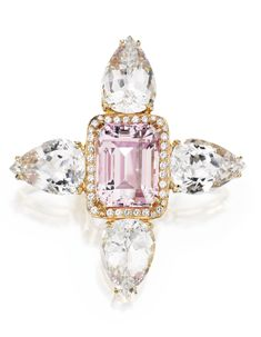 4 KARAT GOLD, KUNZITE, TOPAZ AND DIAMOND BROOCH Centered by an emerald-cut kunzite weighing approximately 73.00 carats, framed by numerous round diamonds weighing approximately 1.90 carats, flanked by four pear-shaped white topazes weighing approximately 138.00 carats.