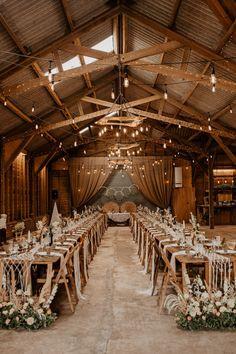 Barn Lights Lighting Flowers Long Tables Decor Whimsical Boho Wedding Camilla Andrea Photography #BarnWedding #WeddingLights #WeddingLighting #WeddingFlowers #LongTables #WeddingDecor #Wedding