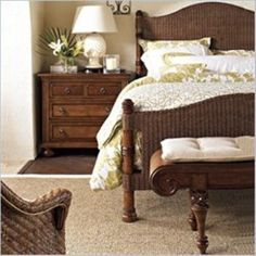 British Colonial bedroom. Love the wicker bedframe and natural wood nightstand.