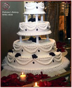 traditional wedding cakes This grand traditional wedding cake is embellished with dark blue buttercream roses. Each tier of the wedding cake is separated with Victorian columns. The cake is completed with white buttercream piping. Wedding Cake Fresh Flowers, White Wedding Cakes, Cool Wedding Cakes, Elegant Wedding Cakes, Beautiful Wedding Cakes, Wedding Cake Designs, Wedding Cake Toppers, Beautiful Cakes, Trendy Wedding