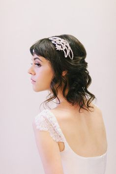 Art Deco Style Crystal Bridal Comb #104HC | This crystal bridal hair comb is perfect that 1920's, 1930's themed wedding.  It is made with Silver Plated Swarovski baguette crystals, and a crystal flower accent.  Wear it in many different positions depending on your hair style.