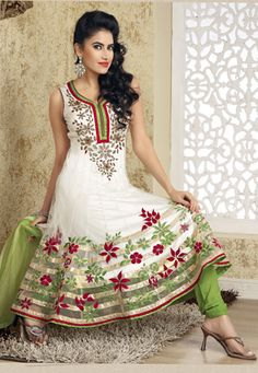 White net resham, zari, stone and patch bordered anarkali kameez. Contrasting green faux georgette churidar and net dupatta comes along with this. Shantoon is used as lining of kameez. (Slight variation in color and patch border is possible.) data-pin-do=