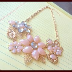 """Pretty in Pink Flower Bouquet Statement Necklace Total chain length = 18"""" including extender piece which is approx. 2.5"""". The necklace has about an 8"""" drop from where the flowers begin. Brand New!                                                          Suggested User✌️     Posh Rules Only <<< MAKE ON OFFER or BUNDLE FOR DISCOUNTED SHIPPING! >>>  Offers are only considered via the Offer Button. If this is priced for less than $10, you're better off bundling for a discount! Ty :) Lindsay's…"""