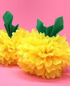 These pineapple pom poms are so easy to make for your next summer party! All you need is some yellow pom poms and some green tissue paper. The perfect quick party decoration for a tropical party, Hawaiian luau or a even a full on pineapple party! Hawaiian Birthday, Hawaiian Luau, Tulle Poms, Pom Poms, Tulle Tutu, All You Need Is, How To Make Tutu, Moana Party, Turu
