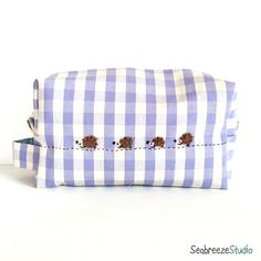lilac gingham pouch with needle felted hedghog family