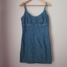 """Vintage Express denim dress Excellent vintage condition! 100% cotton. Made in USA . marked as size 9/10. Armpit to armpit measures 17.5 inches. Length shoulder down 33"""".  Bundle for best deals! Hundreds of items available for discounted bundles! You can get lots of items for a low price and one shipping fee!  Follow on IG: @the.junk.drawer Express Dresses"""