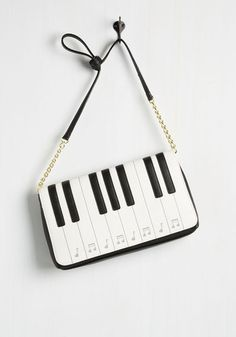 As soon as your radar picks up this quirky purse, you hop on the chance to get involved. A Betsey Johnson style, this vegan faux-leather accessory flaunts a playable keyboard on its flap. Epic, right? Sling this black and white bag's partial chain strap over your ensemble and set out to become a style celeb!