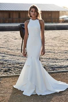 Inspired by the recent Royal Wedding of Prince Harry & Meghan Markle, Meghan wore a halter neck dress by Stella McCartney, we share our favourite halter neck wedding dresses Simple Bridal Dresses, Wedding Dress Styles, Bridal Gowns, Wedding Gowns, High Neck Wedding Dresses, Bride Dresses, Lace Wedding, Modern Wedding Dresses, High Neck Bridesmaid Dresses