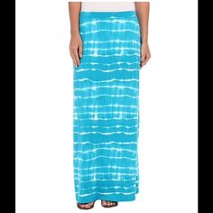 Jones New York Striking Maxi Skirt The perfect staple in your beautifully organized closet. Just remember to make this awesome maxi easily accessible! Relaxed fit gently drapes off of the body for comfort during your busy day. Durable cotton blend construction. Allover tie-dye print. Skirt sits at hip with elastic waist. Straight hemline. 57% cotton, 38% polyester, 5% elastane. Machine wash cold, tumble dry low. Jones New York Skirts Maxi