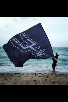 Go Spurs Go!  Spurs coyote takes over the Miami Heat (beach).