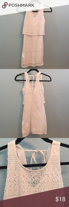 Cute white lace dress White lace dress with overlaying top and tie in the back. Worn once to 16th birthday party. Dresses Midi