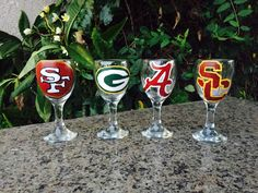 Football hand painted wine glass Broncos by BinkiHandPaintedGlas Artist owner Danielle Darrow from Lakewood California Los Angeles county