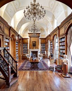 This room screams elegance — it's absolutely stunning! The rug, fireplace and statues are works of art. Oh, and let's not forget about the jaw-dropping chandeliers. Beautiful.  http://blog.laurelandwolf.com/gorgeous-libraries-to-inspire-your-home-library/?utm_source=pinterest&utm_medium=email&utm_content=gorgeous_libraries&utm_term=8_25