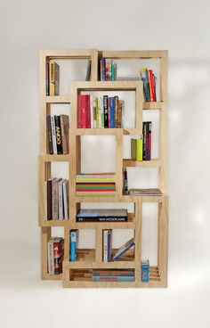 FRAMES is a bookcase that consists of five layers of plywood. The frames have different sizes and depths, so that for any size book is an appropriate place.    The cabinet can be stand alone in the room.  Other wood species, sizes and frame formats desired are possible.    Dimensions and material cabinet on photos:  H 180 x W 100 x D 38 cm, 18 mm Radiplex. Design: Gerard de Hoop