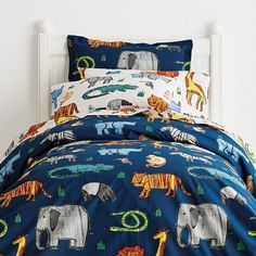 Smooth cotton percale kids sheets & bedding set displaying a wild kingdom of colorful hand-drawn animals. Smooth cotton percale.