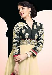 A desire that evokes a sense of belonging with a striking details. The dazzling black and cream faux georgette churidar suit have amazing embroidery patch work is done with resham, zari, sequins and beads work. The entire ensemble makes an excellent wear. Matching black santoon churidar and red faux chiffon dupatta is available with this suit. Slight Color variations are possible due to differing screen and photograph resolutions.