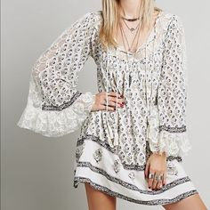 Free People Nomad Child Dress Ivory, Small BRAND SPANKING NEW- Free People Nomad Child Dress, Ivory Combo, Size Small- Lace panels accent the yoke and sleeves for a peek of skin on this Free People dress with an airy profile. Floral pattern and bell-sleeves further the boho styling. Tasseled ties close the partial front placket. Long sleeves. Lined. Fabric Gauze. Shell: 100% cotton. Lining: 60% rayon/40% cotton. Hand wash or dry clean. Imported. Measurements Length: 32.75in / 83.5cm, from…