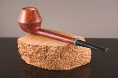 DIMENSIONS AND OTHER DETAILS Shape: Pencil shank Rhodesian Material: Briar Finish: Rusticated/Smooth Stem material: Ebonite Filter: None Condition: New Signature: JP Pipes and turtle-shape stamp On request, Im willing to pre-carbonize the chamber. I leave it to you to make the decision