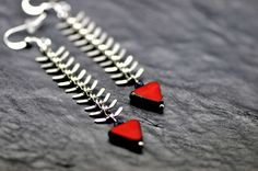 Silver Fishbone earrings, made with silver tone fishbone chain and triangular red czech glass beads on Etsy, $20.00