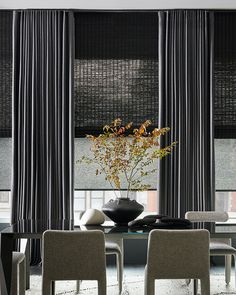 Bold layers of shades and drapery suit the scale of dramatic floor-to-ceiling windows, awakening the senses. Get the look at theshadestore.com. #LoveYourWindows // Trim by Samuel & Sons