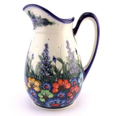 Majestic pitcher by Ceramika Kalich. These large flowers are hand-painted while their centres are hand-stamped. Love this piece of art :) See more Polish pottery at http://slavicapottery.com