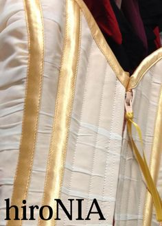 external bone casings from gold satin+zipper closure in the front