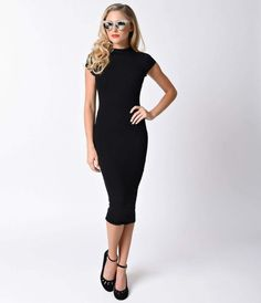 Its always time for the perennial belle! This stunning all over black wiggle dress is a soft and stretchy knit lined crepe. With a regal high neckline and small cap sleeves, this ravishing silhouette has fitted elegance while maintaining your sultry side